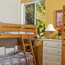 Comfortable ashram bedrooms are divided by men and women.