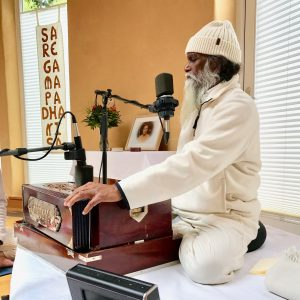 Shri Yogi Hari playing Harmonium in Hellenthal, Germany practicing Nada Yoga